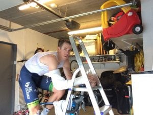 "Hayman recovering in his garage. He says ""I was embarrassed by this photo. There's a fine line between stupidity and dedication."""